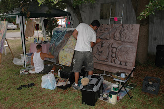 Photo: left to right: artists Brent Wheelwright and Teig Grennan working on their murals