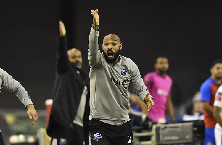 Head coach of the Montreal Impact Thierry Henry reacts after a decision was taken to reverse a penalty shot awarded to the Montreal Impact against CD Olimpia in the second half during the 1st leg of the CONCACAF Champions League quarterfinal game at Olympic Stadium on March 10, 2020 in Montreal, Quebec, Canada. CD Olimpia defeated the Montreal Impact 2-1.