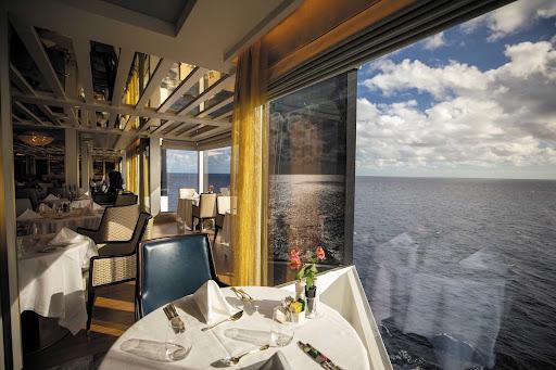Enjoy sweeping seascapes while dining at La Veranda on Seven Seas Splendor.