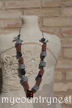 Photo: collana roll di lana grigio e rosso