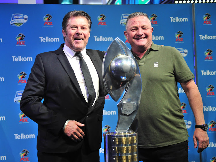 Free State Stars Belgian coach Luc Eymael (L) with his Bidvest Wits counterpart Gavin Hunt pose for photographs of the 2018 Telkom Knockout trophy at the SuperSport studios in Randburg after the draw that pitted the two teams against each other.
