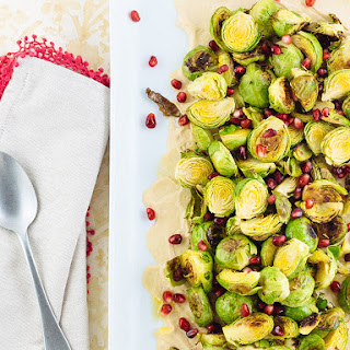 Roasted Brussels with Hummus & Pomegranate.