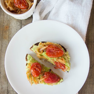 Avocado Toast with Caramelized Onions and Tomato.