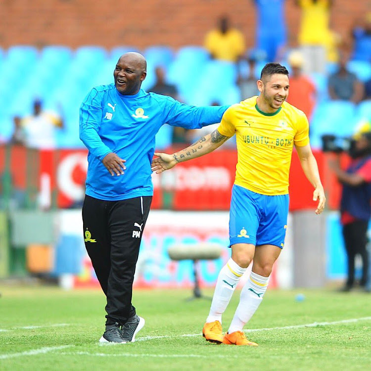 Mamelodi Sundowns coach Pitso Mosimane celebrates with striker Ali Meza.
