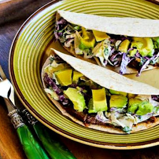 Slow Cooker (or Pressure Cooker) Shredded Beef Tacos with Spicy Slaw and Avocado.