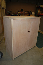 Photo: 2 door Sing Wood Chest styled Honeycomb Armoire. Lifetime structural guarantee of our sandwich torsion box panels. Northwest Cedar with a natural Eucalyptus inlay and Birch sides. This beautiful lightweight sandwich panels makes our Armoire a great storage chest that is easy to transport, move. Built with the strongest lightweight Eco-Friendly furniture ever invented, guaranteed!