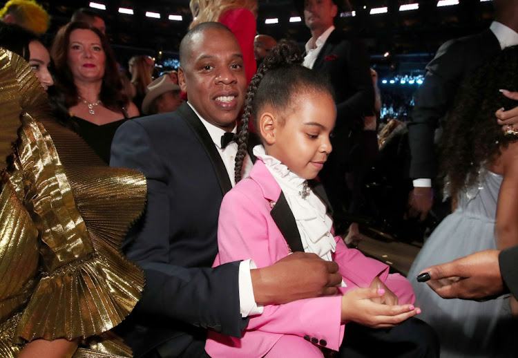 Hip-Hop Artist Jay-Z and daughter Blue Ivy Carter during the 59th Grammy Awards in 2017.