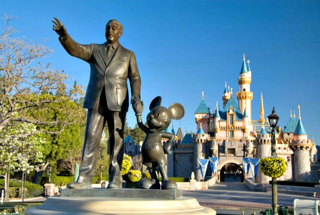Walt and Mickey in front of the Sleeping Beauty Castle.