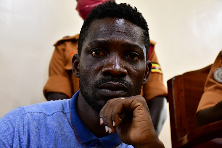 Ugandan presidential candidate Robert Kyagulanyi also known as Bobi Wine is seen inside the courtroom in Iganga, eastern Uganda November 20, 2020.