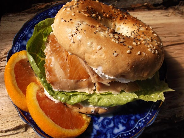 Place lettuce on bottom bagel half; place smoked salmon on lettuce and cover with...