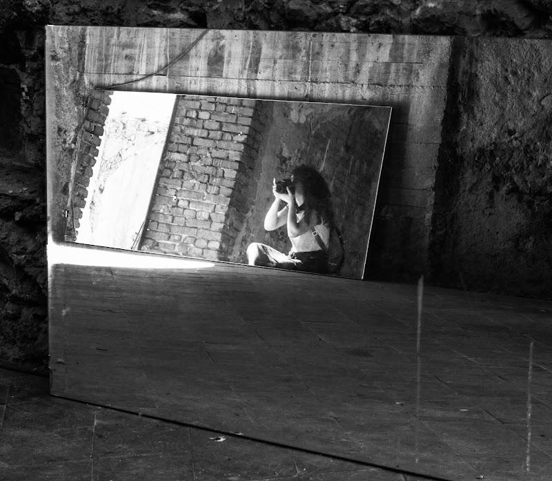 Fotografa in riflesso di Merlograziano