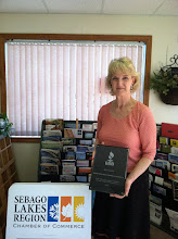Photo: Point Sebago Lakes Region Chamber Of Commerce in Windham, ME accepting their 25 Year Accreditation Achievement Plaque