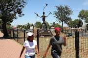 A new fence surrounds the sculpture by professor Pitika Ntuli in honour of the Silverton Three in Diepkloof.