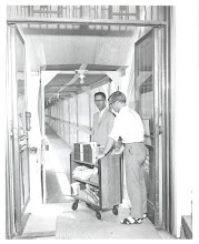 Photo: first truck of books on the way to the new Howard-Tilton from the old Howard-Tilton (now Jones Hall) through the covered bridge, 1968