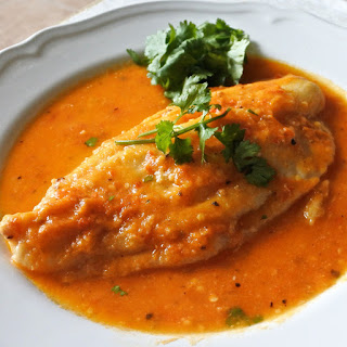 John Dory poached in a spicy tomato, chile and wine broth.