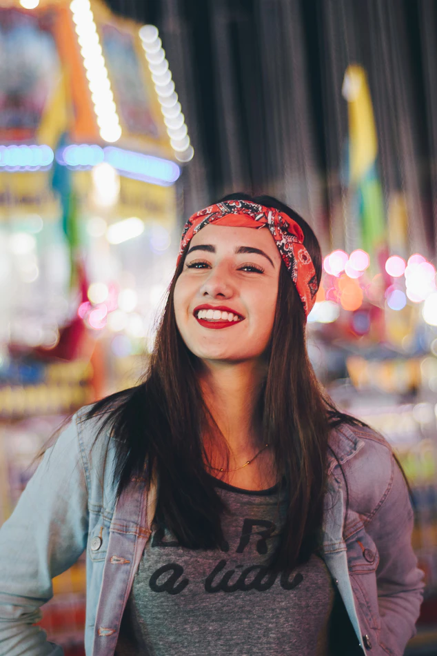Woman with red bandana at carnival