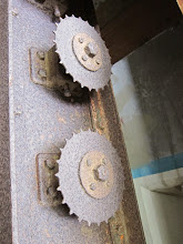 Photo: Old gears used to raise ammunition.