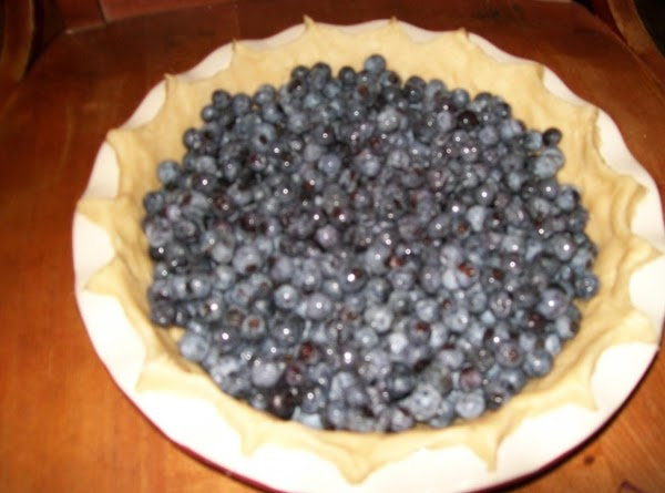 Wash blueberries, drain well; place blueberries in pie shell.