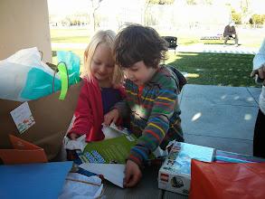 Photo: Clark Opens A Present From Rebecca