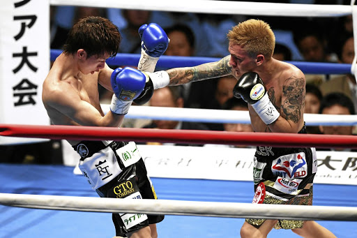 Hekkie Budler connects his right on Ryoichi Taguchi of Japan in a previous fight. / Getty Images / The Asahi Shimbun