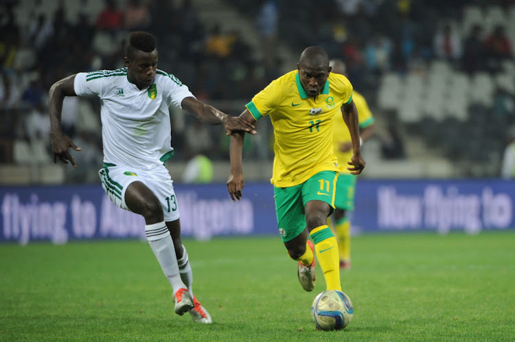 Aubrey Modiba of Bafana Bafana is challenged by Bakary Ndiaye of Mauritania during the AFCON Qualifier match between South Africa and Mauritania 02 September 2016 at Mbombela Stadium.