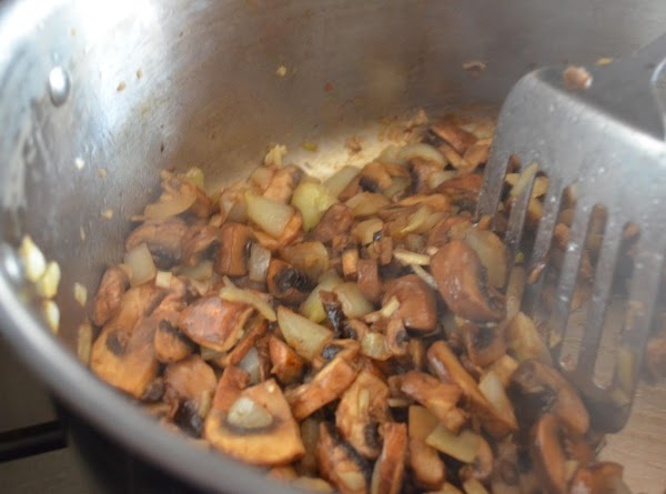 In a large stock pot add butter, olive oil, onions and garlic. Saute until...