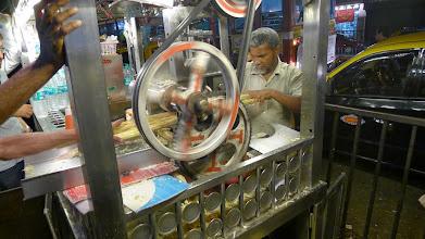 Photo: making sugar cane juice