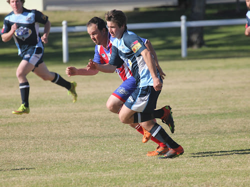 Wee Waa's Jerry Wohling and Narrabri FC's Daniel Hall race to the ball in Narrabri FC's 5-0 win on Saturday at Hogan Oval.