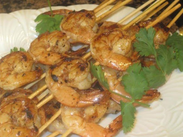 Since you'll be grilling the shrimp, soak wooden skewers in water for 1/2 to...