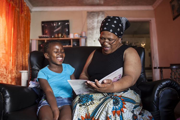 Nomfanelo Bovu reads a special story to her granddaughter Olitha Mangcayi during this time of isolation.