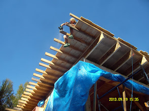 Photo: Trimming back for the fascia boards.