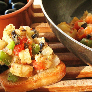 Sautéed Cod with Vegetables and Olives.
