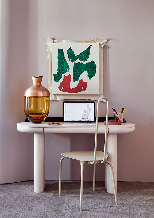 A Jumbo desk/dressing table, Paperclip chair, and artwork by Claire Johnson in the main bedroom.