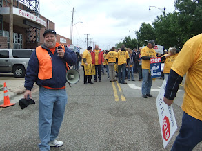 Photo: Tim O'Conner of the Central Oklahoma Labor Federation gets ready to lead the march.