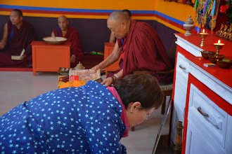 Photo: During the Grand Opening Event held for Sowa Rigpa Medical Institute, Jetsun Ma, on behalf of Yuan Yuan Educational Foundation, offered a khadda before the Medicine Buddha altar in respect.