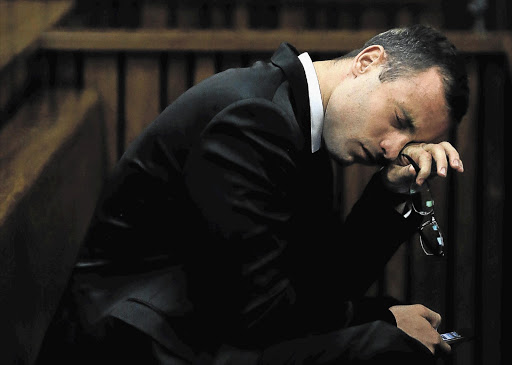 Oscar Pistorius in the Pretoria High Court before he took the stand for the first time in his trial for the murder of Reeva Steenkamp. He spoke of his long-term terror of criminals.