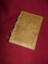 Photo: The outer cover of the Wax Tablet showing the thonged hinge and the stylus. It would have only really been used for notes to be then copied onto something more permanent. The stylus can erase the text with the flattened end, but the best results can be had by warming the wax or even heating the end of the stylus and using that to erase the inscription. The Romans used wax tablets much like this which had up to three leaves and sealed with lead stamps.