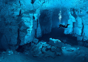 """Photo: Orda Cave: World's Longest Underwater Gypsum Cave in Russia  """"Located near Orda village in Perm region, Ural, Orda Cave is also the biggest underwater gypsum crystal cave in the world and second in Eurasia in terms of volumes of its galleries that stretch up to five kilometers. Over a period of six months, famous underwater photographer, journalist and dive-instructor Victor Lyagushkin led the team of cave divers and took stunning images of the cave at less than zero degree temperature. The location of the cave in Ural region, which is known for rich mineral deposits in Russia, may be linked to the gypsum content in Orda Cave, which has transparent water because of the mineral. ..."""" more photos: http://goo.gl/cLFnE"""