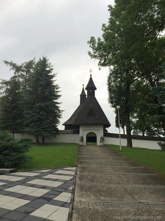 Entrance to the cemetery with the wooden church, Tvrdosin, Slovakia