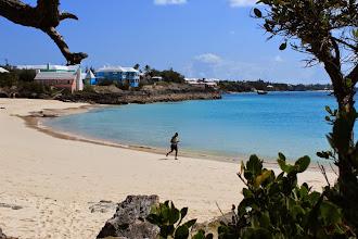 Photo: Jogger on east coast beach