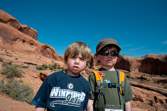 Photo: The two boys, handing out on the way down, with Corona Arch in the background.