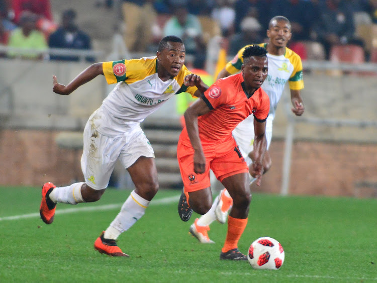 Mamelodi Sundowns attacking midfielder Lebohang Maboe (L) challenges Vusimusi Mngomezulu of Polokwane City during the Absa Premiership match at Peter Mokaba Stadium in Polokwane the on August 7 2018.