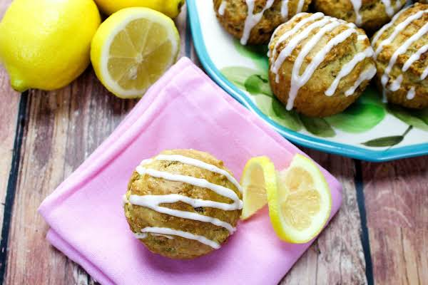 Frosting Drizzled On Lemon Date Muffins.