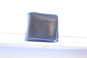 Photo: Wallet by the Window Requirement 1 (Poor exposure) 0.5 sec, f/4.0, ISO 100 I put my wallet by the window during daytime and took an overexposed picture. The slow shutter speed of 0.5 sec and medium aperture opening f/4.0 were enough to make the background look completely white.