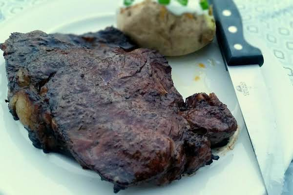 Marinated Grilled Ribeye With Baked Potato Side.