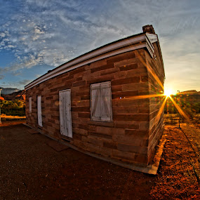 Pioneer Sunrise by Jordan Wangsgard - Buildings & Architecture Homes ( clouds, fisheye, building, pioneer, block, yellow, sun, sky, red, blue, utah, mortar, sunrise, dirt )