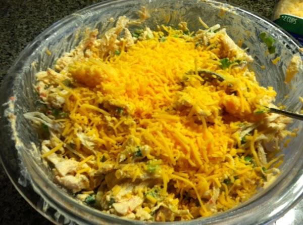 Sprinkle in 1-1/2 c shredded cheese.