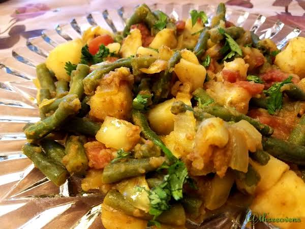 Potatoes With Green Beans On A Clear Plate.