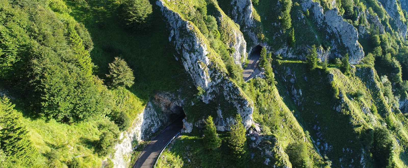 Cycling Monte Grappa - Cavaso del Tomba - aerial drone photo of tunnels and cliff