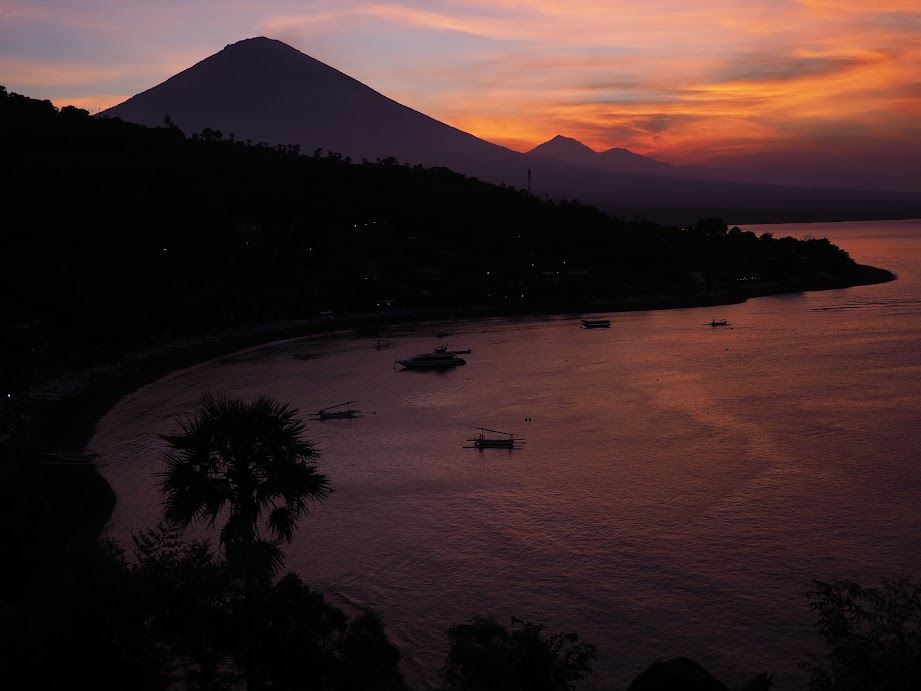 Jemeluk Bay, Amed at sunset. Notice the three volcanoes on the background.
